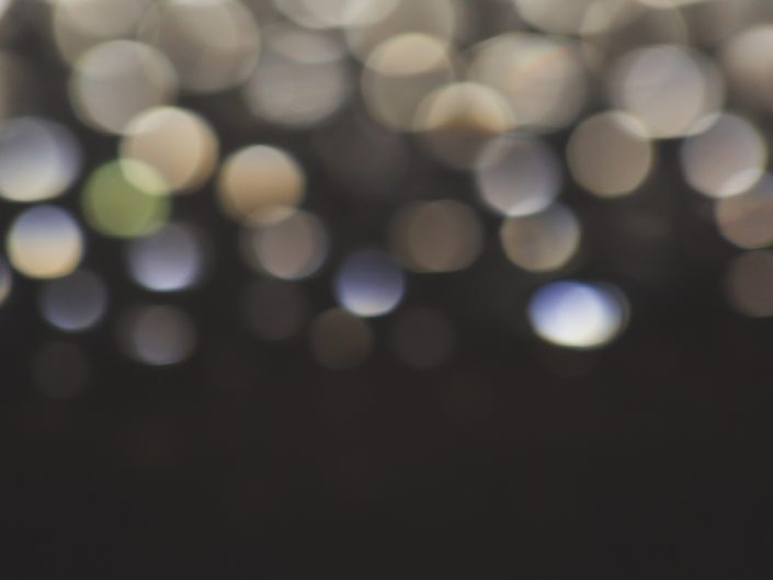 abstract macro image of bokeh on a dark background