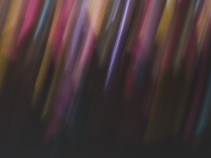 abstract image of many linear colors on a dark background