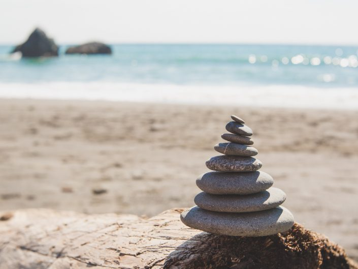 zen stack of rocks at the beach